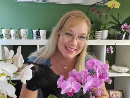 Amanda Matthews, Orchids, and Midnight, her cat